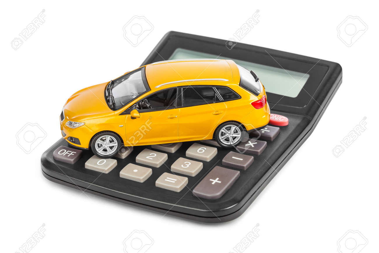 Calculator and toy car isolated on white background - 46120829