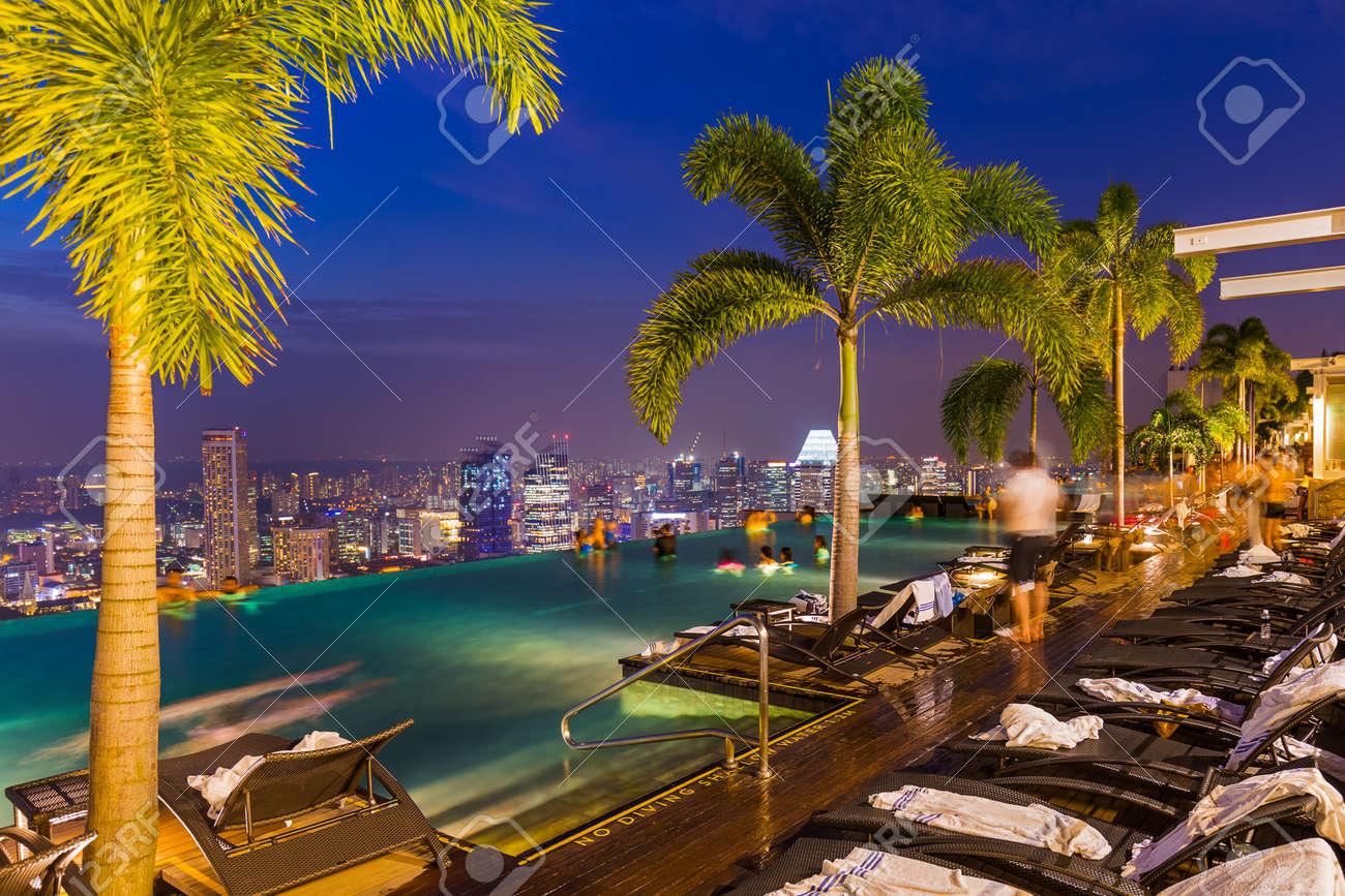 Pool on roof and Singapore city skyline - architecture and travel background - 57925031