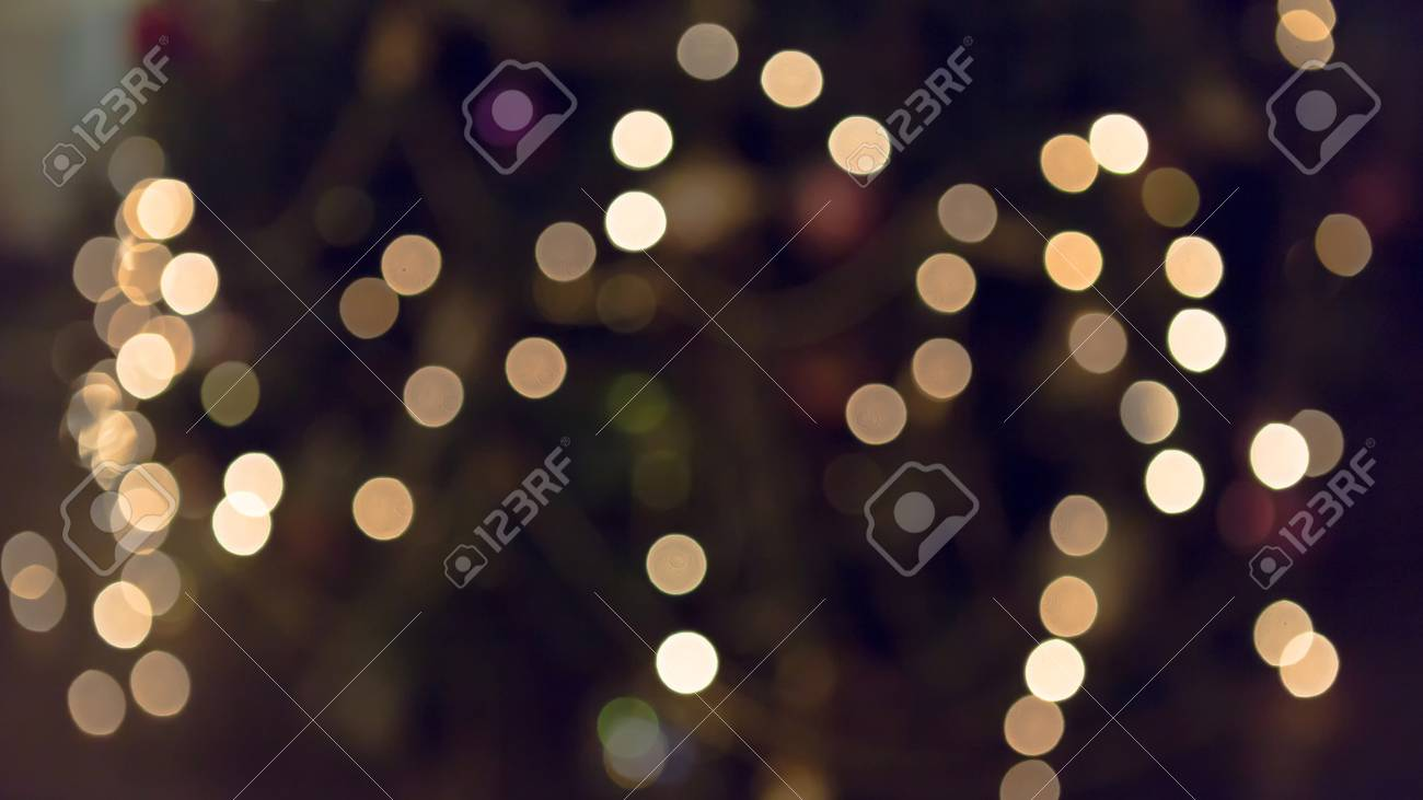 blurry background of glittering christmas lights closeup shot stock photo 46744643 - Blurry Christmas Lights