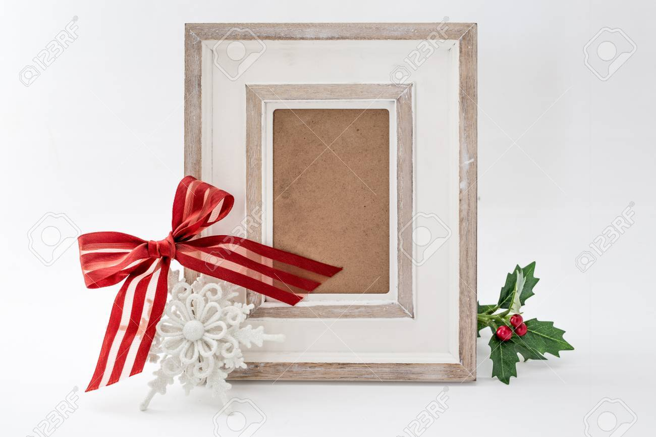 Closeup Of Picture Frame Decorated With Red Ribbon Stock Photo