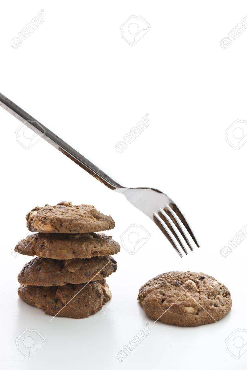 Eat cookie with fork , comparison about eating fat thin Stock Photo - 13207159