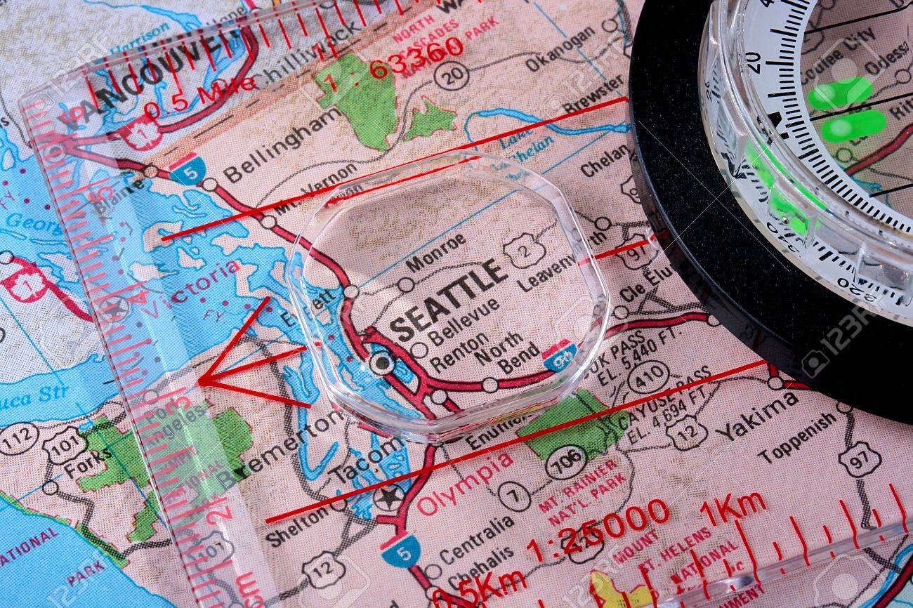 USA Map With The City Of Seattle And A Compass With Magnifying - Usa map seattle