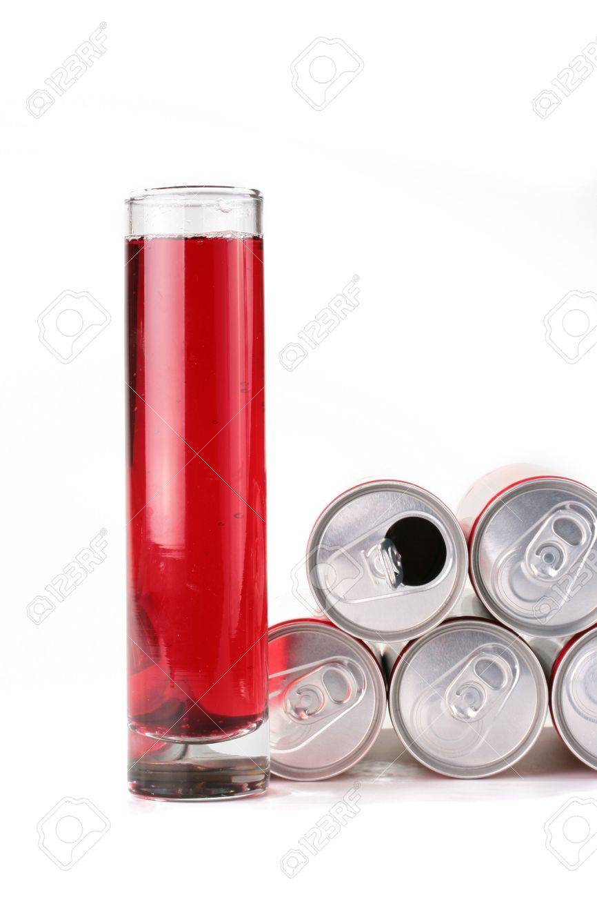 The high glass narrow glass with a drink of red colour and containers from a tin in which is stored this drink. Stock Photo - 6320442