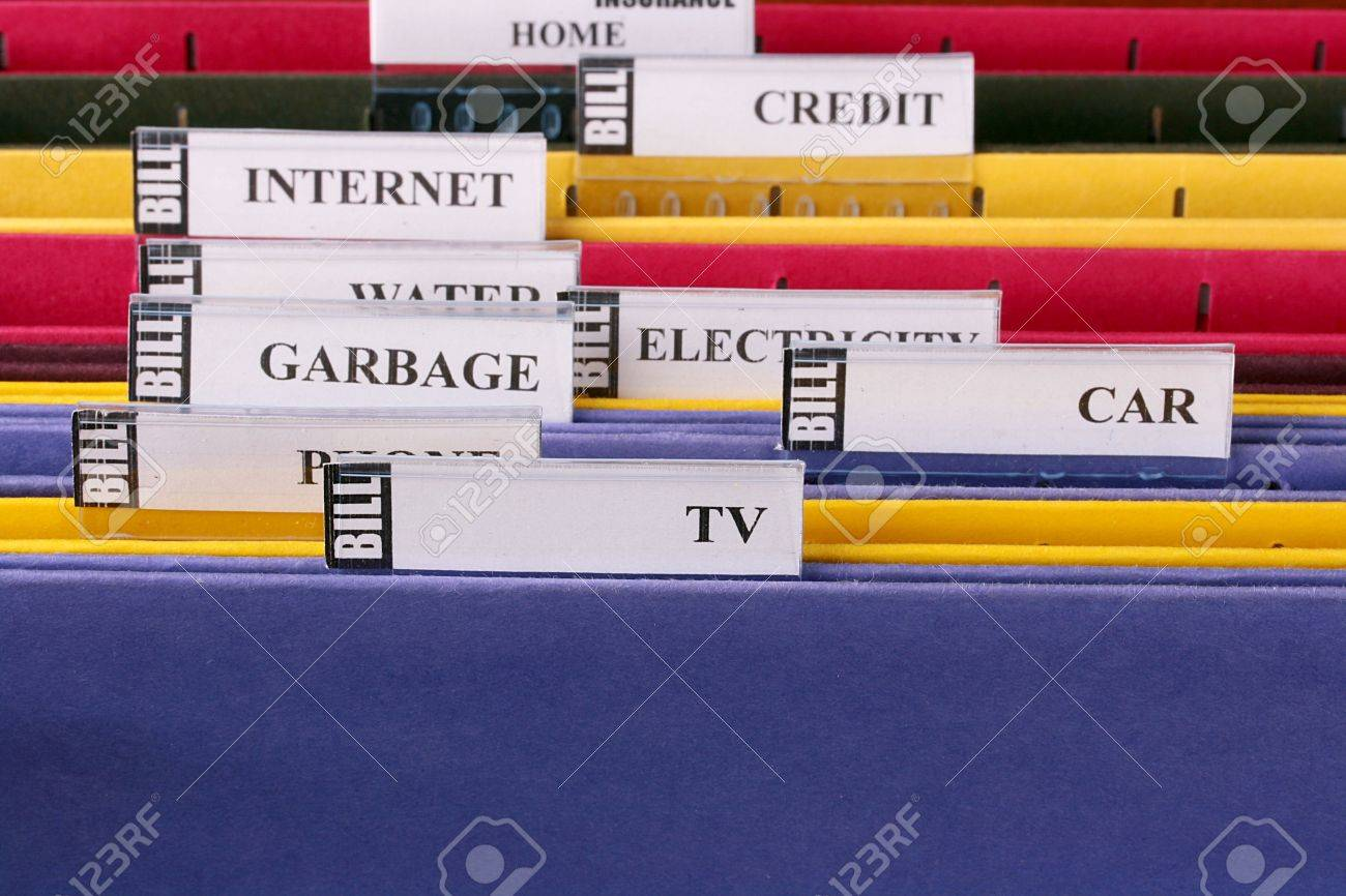 Folders for storage of documents in archive for the payment of invoices. Stock Photo - 6365771