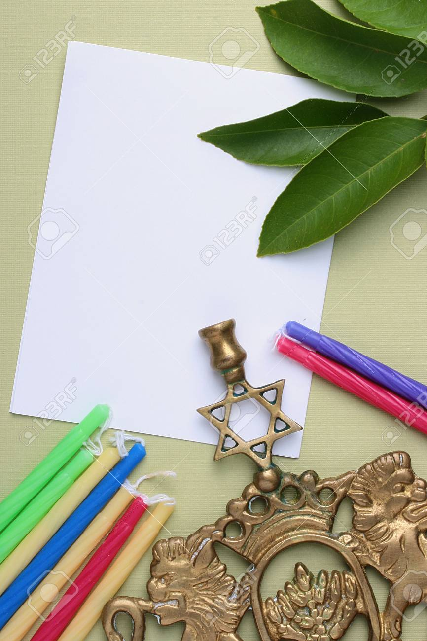 Menorah and candles next to a piece of white paper. Add your text to the paper. Stock Photo - 7578515