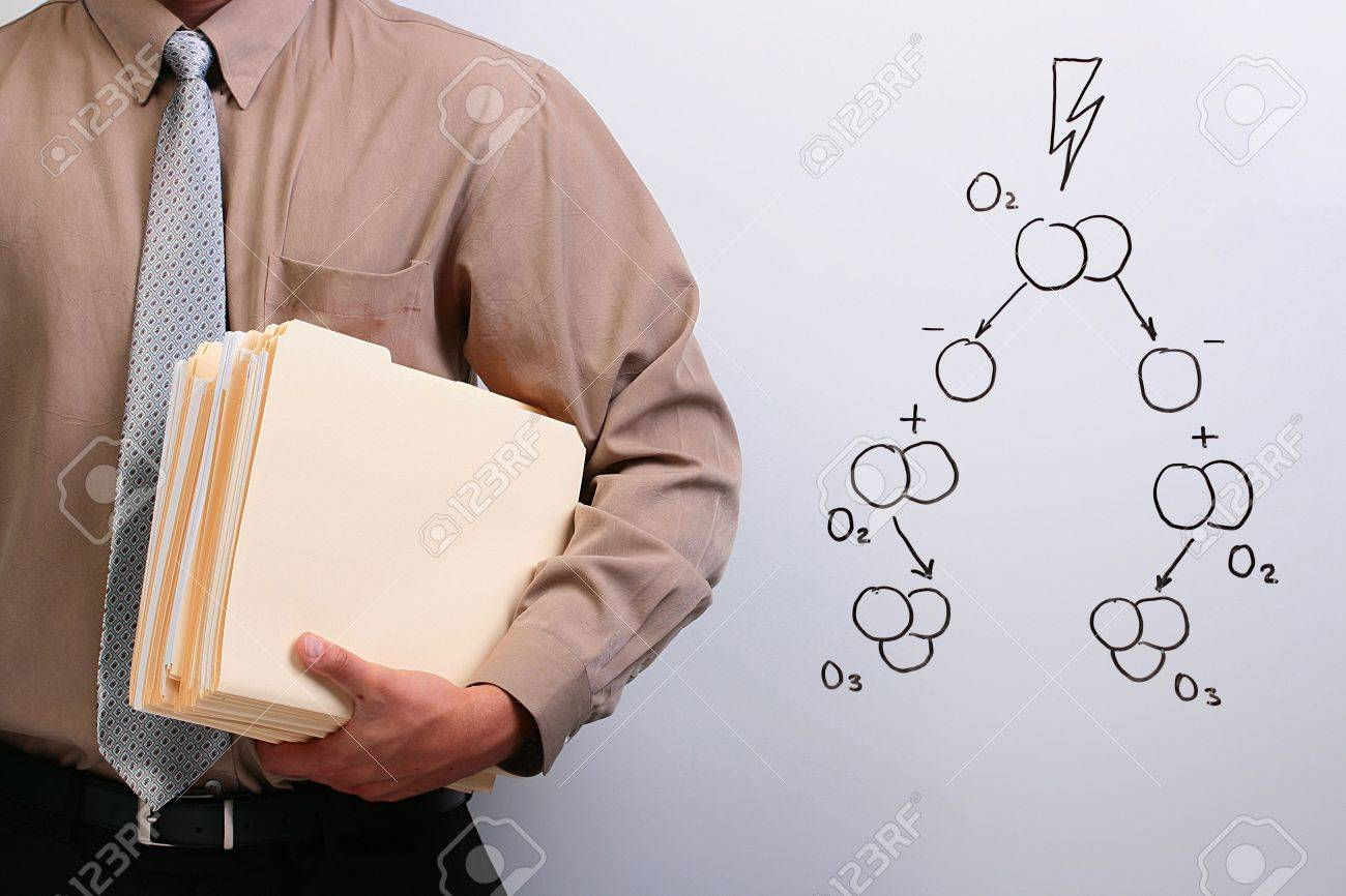 Man in a shirt and a tie holding manila folders while standing next to a drawing of ozone formation. Stock Photo - 7671132