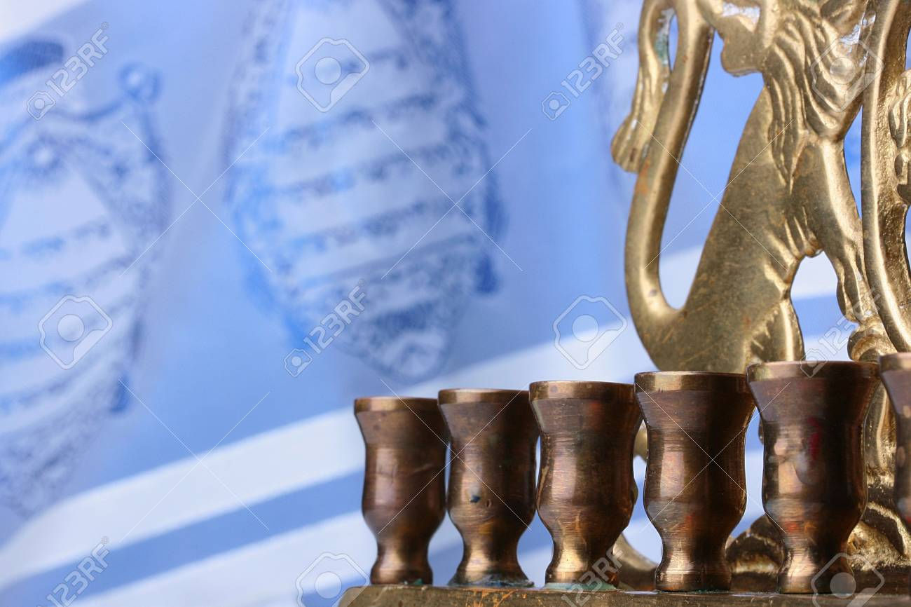 Menorah in front of a blue and white tallit. Add your text to the background. Stock Photo - 8006684