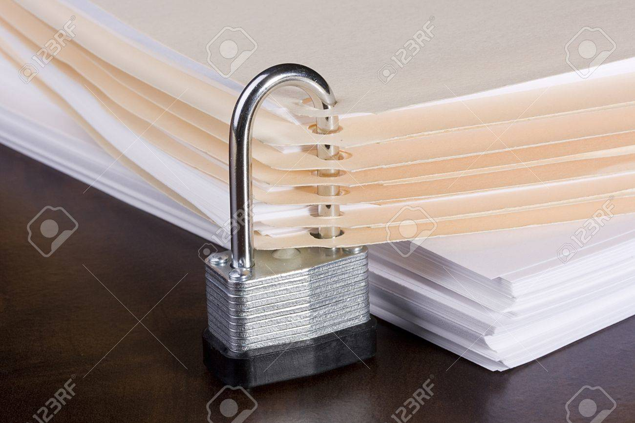 Stack of folders closed with a metal lock. Stock Photo - 8520028