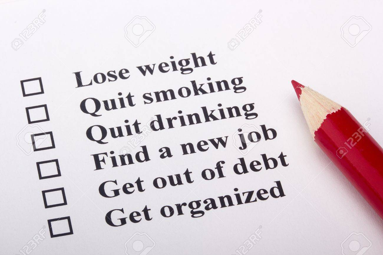 A red pencil laying on a paper with a list of goals. Stock Photo - 9077299