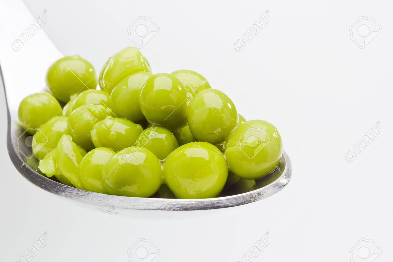 Close-up photograph of green peas on a spoon. Stock Photo - 11968499