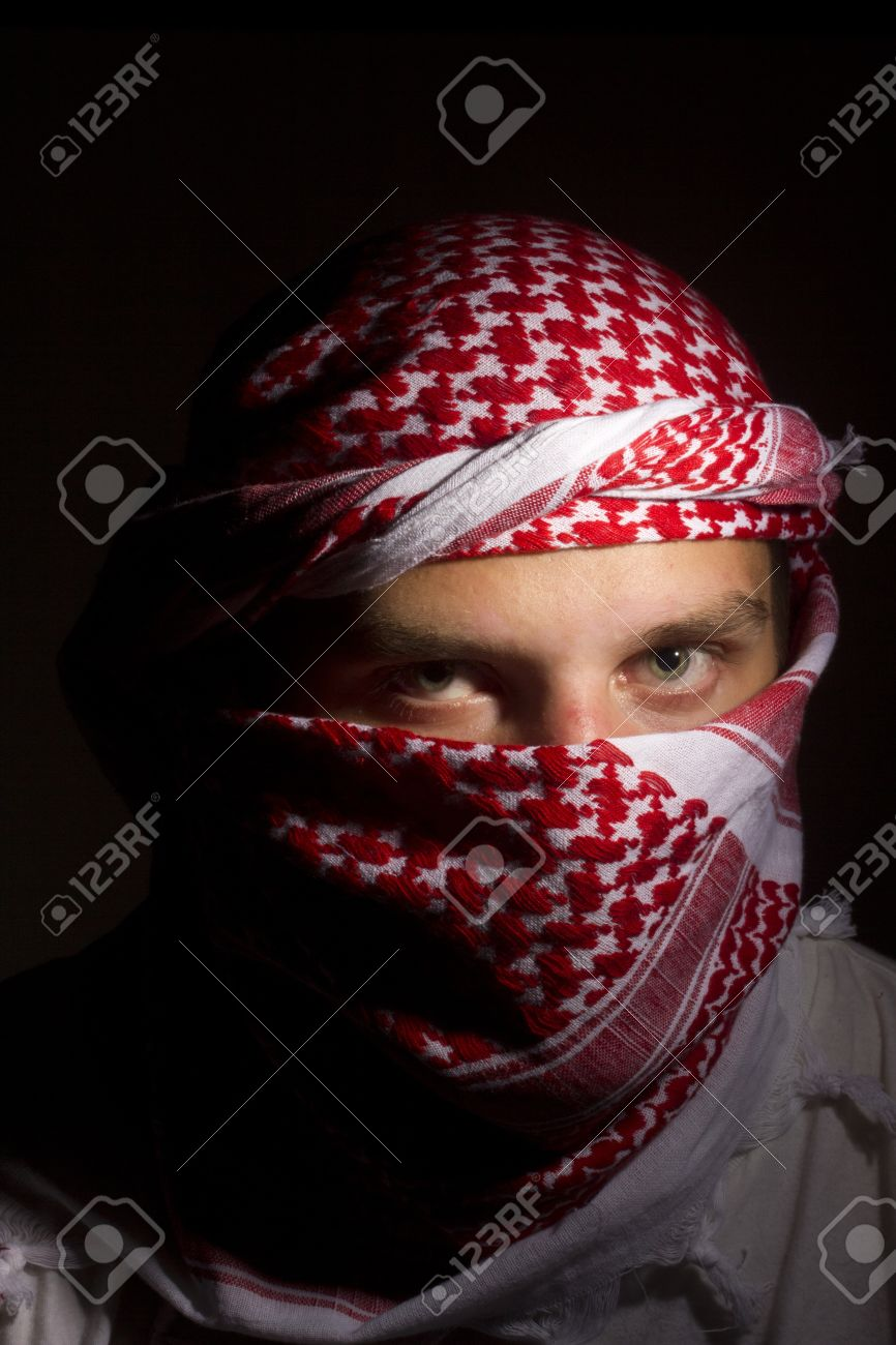 Close-up photograph of a man in a red keffiyeh. Stock Photo - 12538928