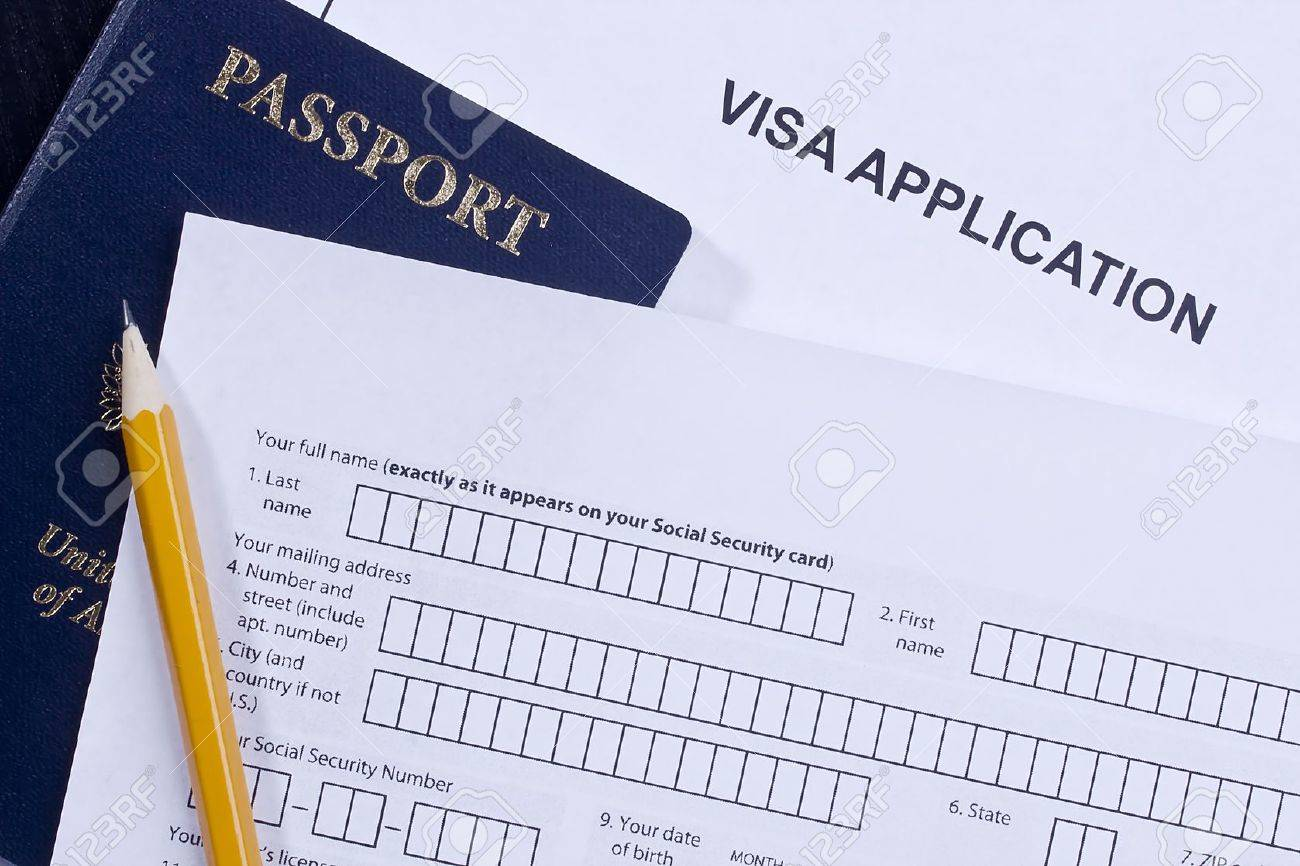 Directly above photograph of an application for a visa. Stock Photo - 14519027