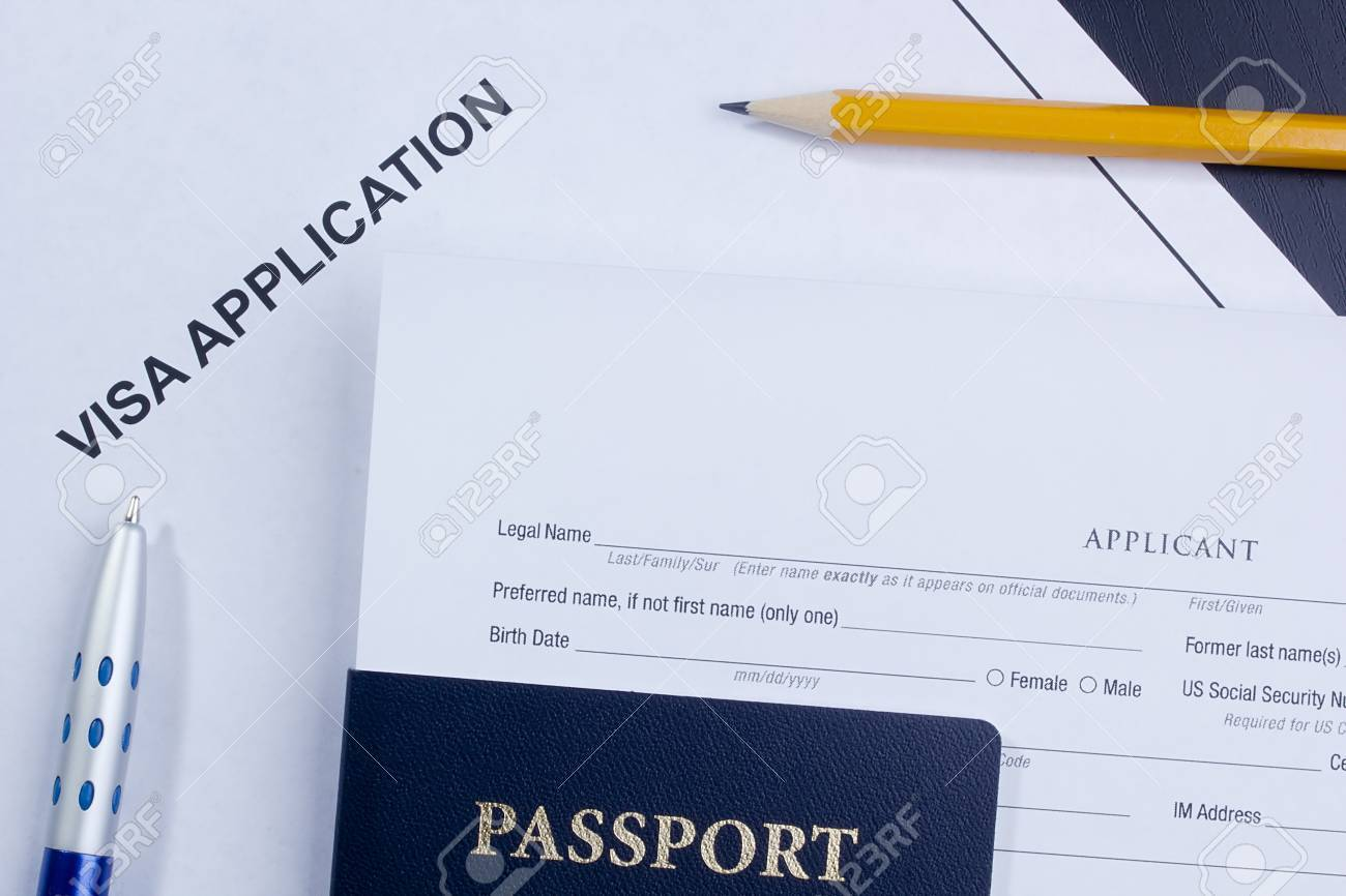 Directly above photograph of an application for a visa. Stock Photo - 14793123