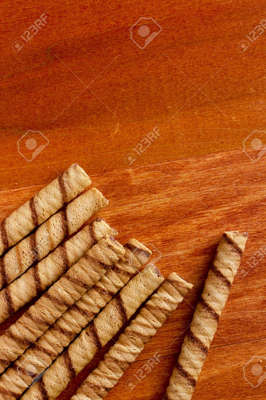 Rolled waffles with hazelnut on the wooden background Stock Photo - 22870205