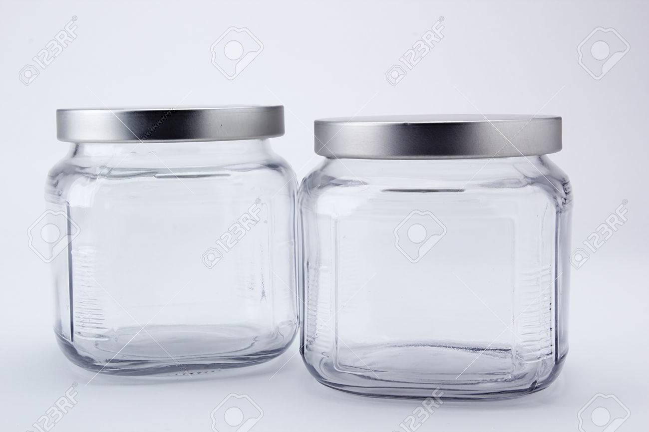 two faceted jars with lids for kitchen use stock photo picture and