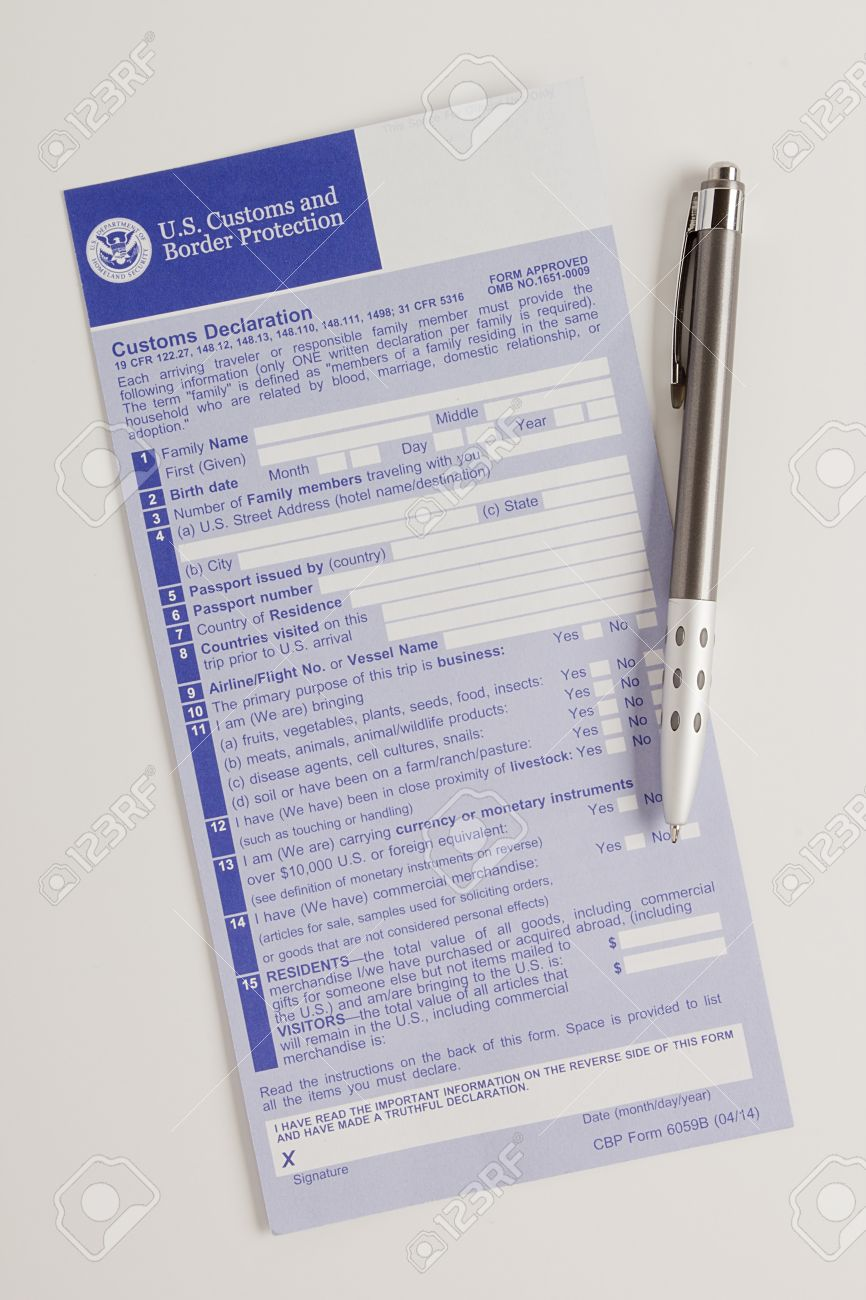 The customs declaration form and a pen to fill in on a white stock stock photo the customs declaration form and a pen to fill in on a white background thecheapjerseys Choice Image