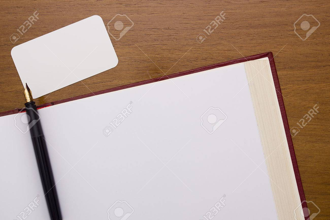 Thick Book With A Clean Slate And A Blank Business Card. Stock Photo ...