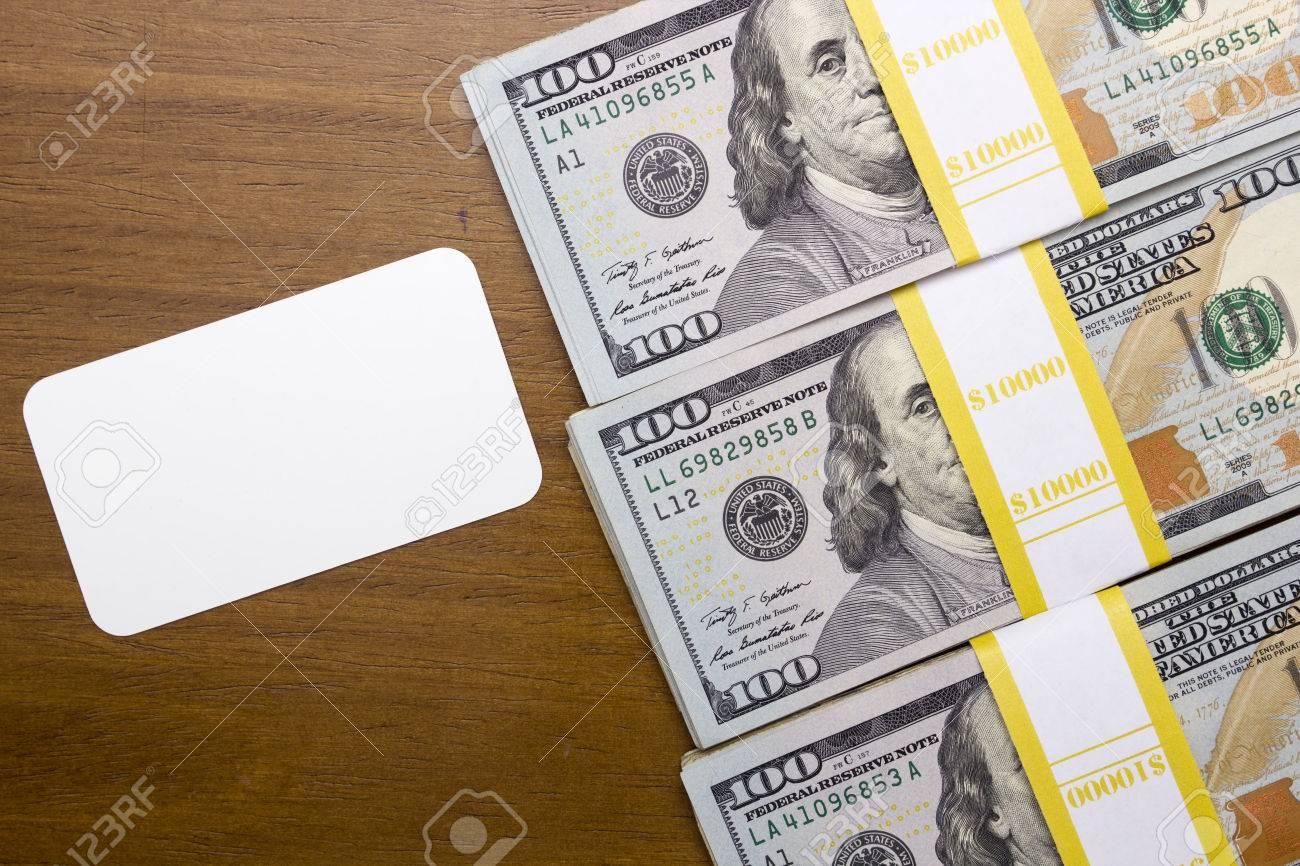Bundles Of Hundred Dollar Bills Next To An Empty Business Card ...