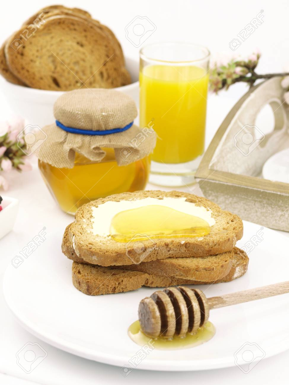 Honey on toast, with a breakfast set background Stock Photo - 9102738