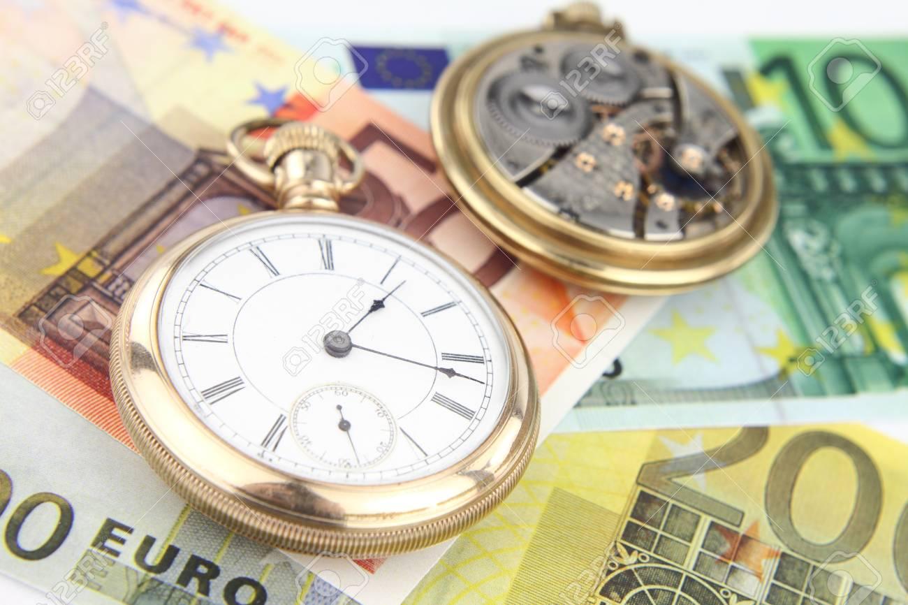 Antique pocket clock and money Stock Photo - 10416174