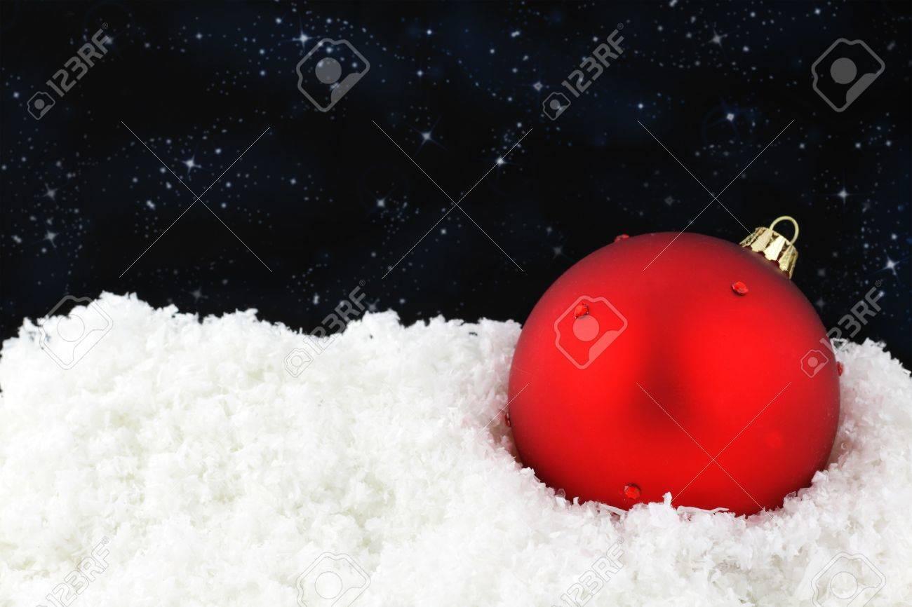 Red Christmas ball on snow Stock Photo - 10600290