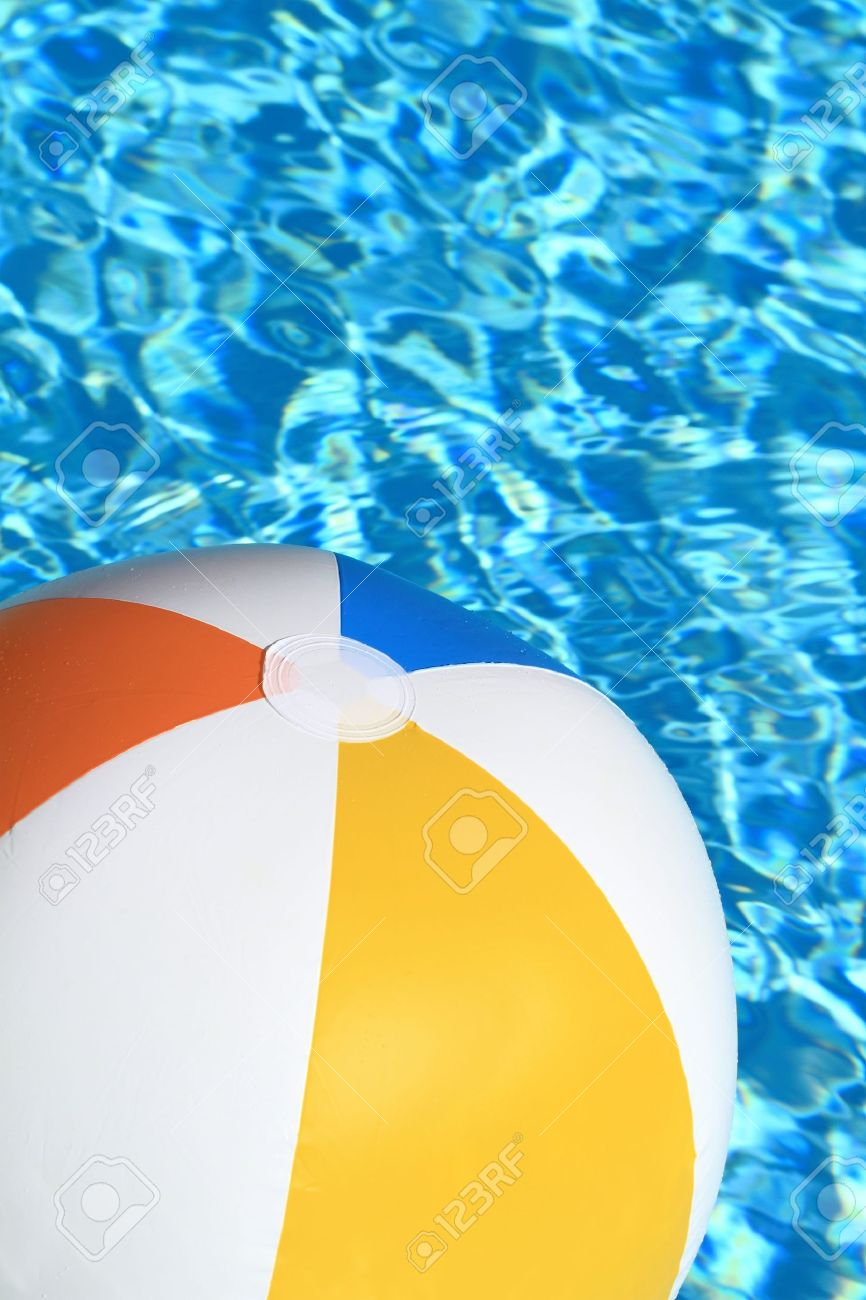 Pool Water With Beach Ball summer background. beach ball on the swimming pool stock photo