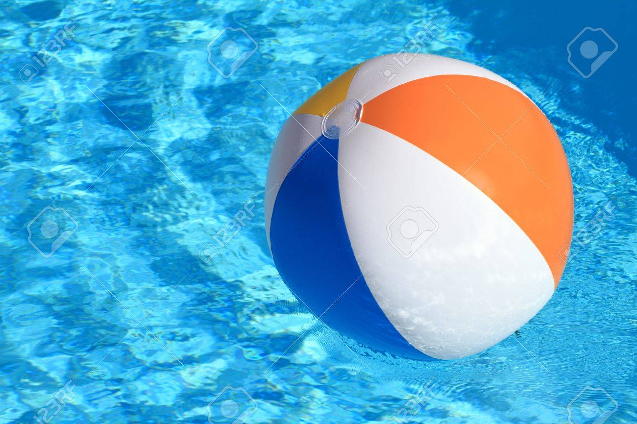 swimming pool beach ball background. Stock Photo - Summer Background. Beach Ball On The Swimming Pool Background A
