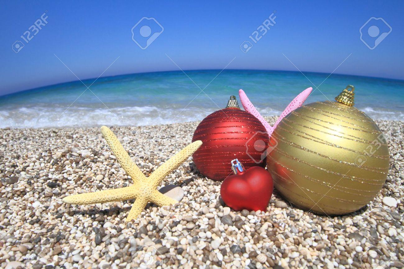 Christmas beach ornaments - Christmas Ornaments On The Beach Stock Photo 14472178