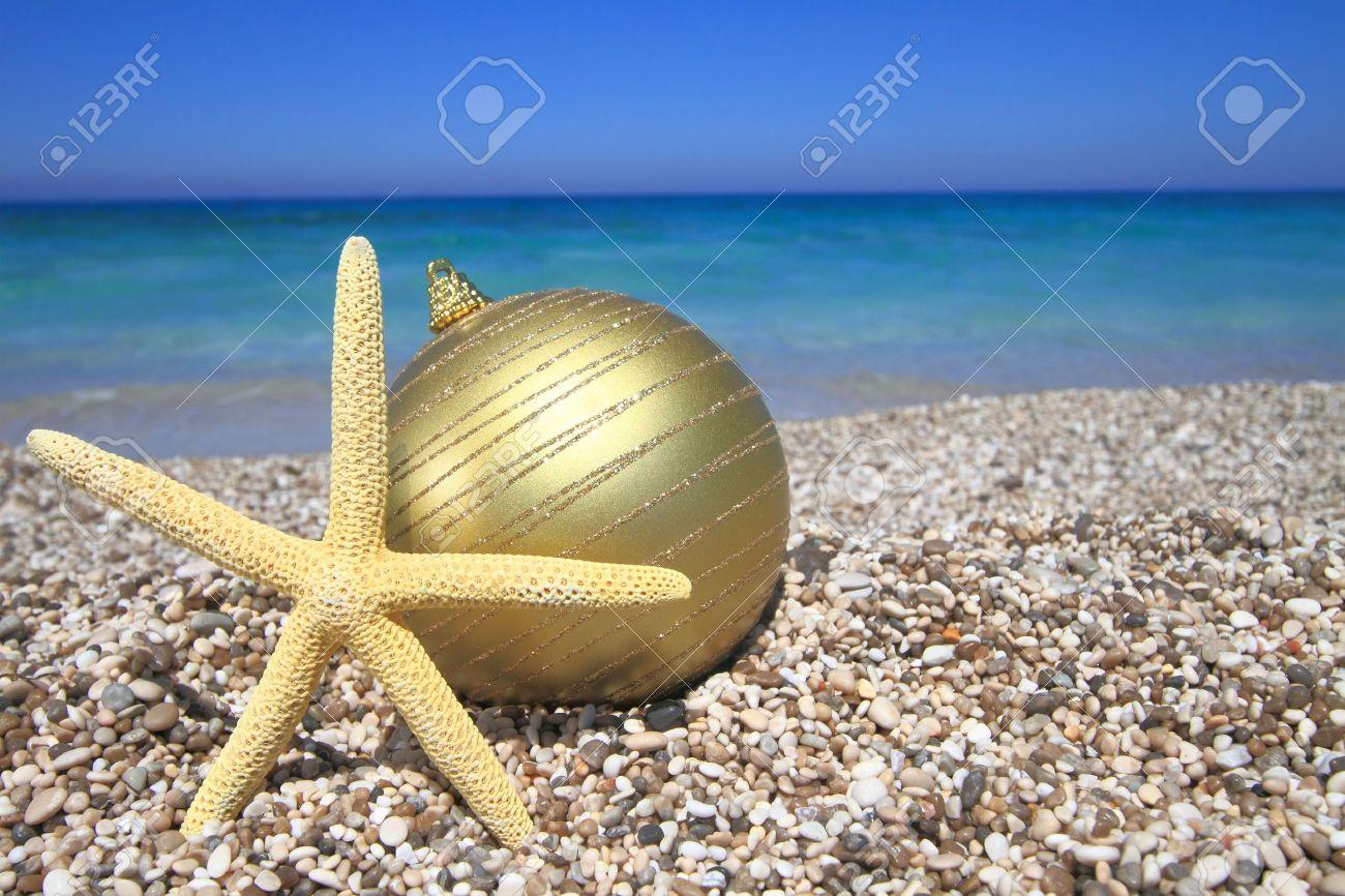 Christmas beach ornaments - Christmas Ornaments On The Beach Stock Photo 14472250