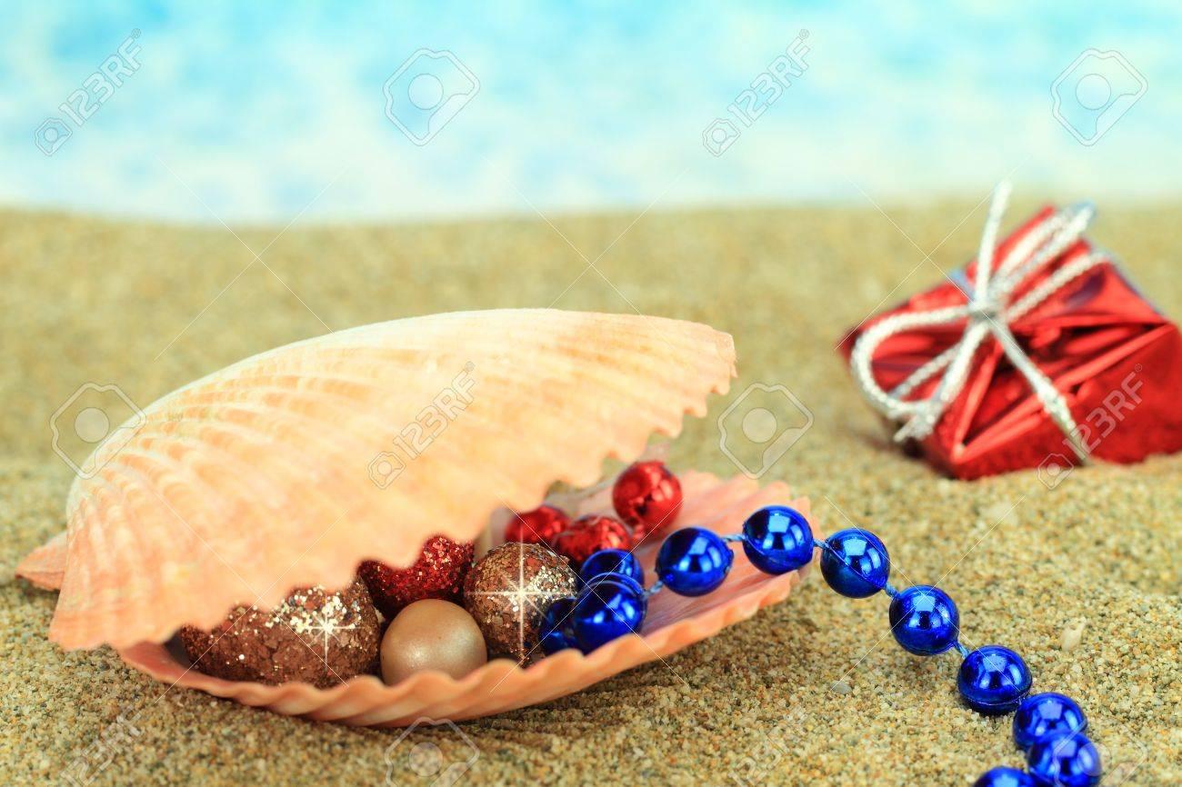 Christmas beach ornaments - Christmas Ornaments In A Sea Shell On The Beach Stock Photo 15117006