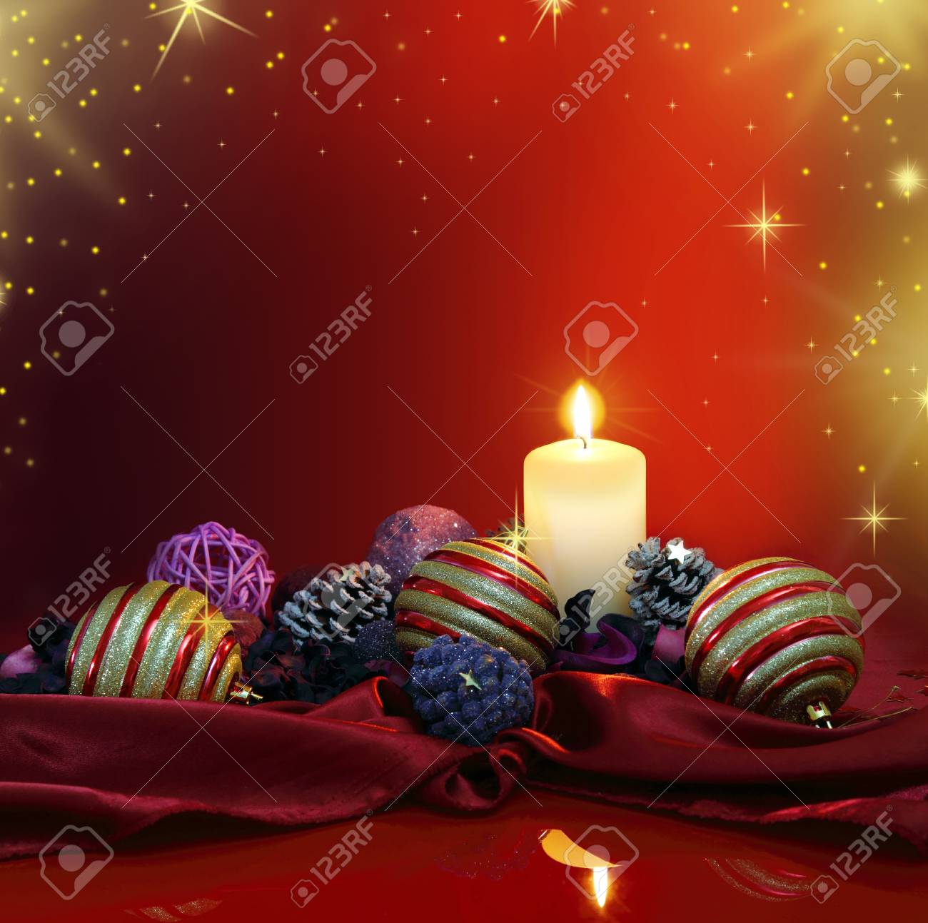 Christmas composition with candle and colored potpourri Stock Photo - 16698847