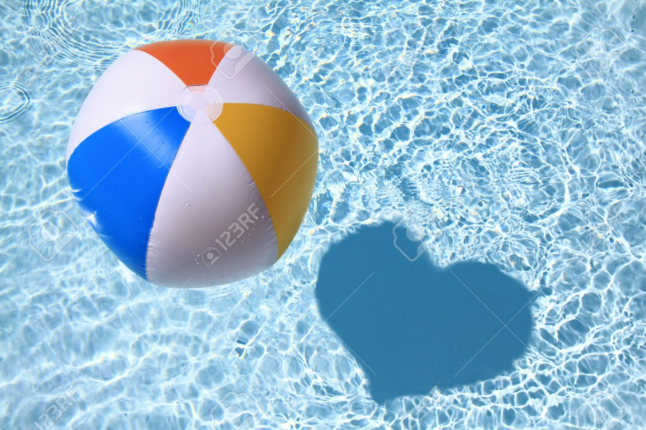 Summer Love, Beach Ball On The Swimming Pool With Heart Shaped Shadow Stock  Photo