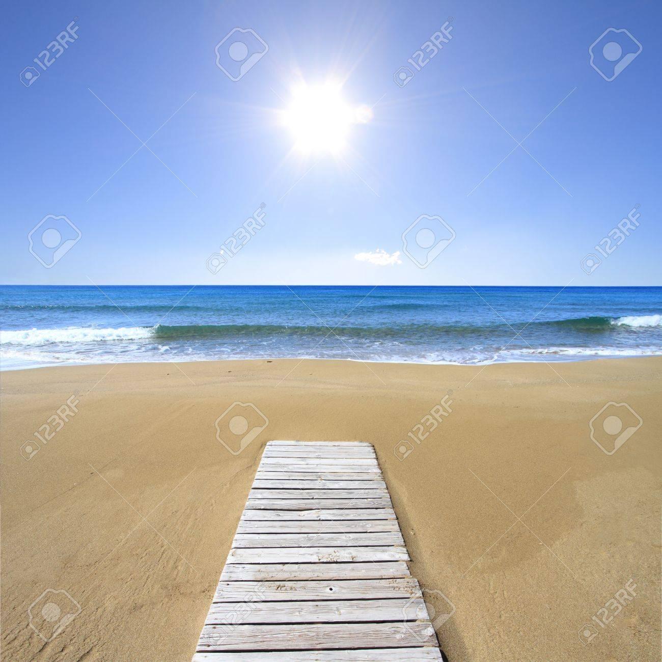 Wooden floor on golden sandy beach Stock Photo - 18866377