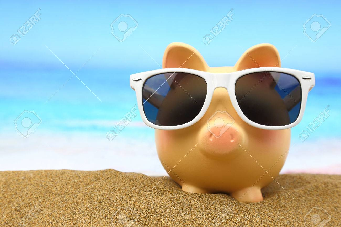 Summer piggy bank with sunglasses on the beach - 26815423