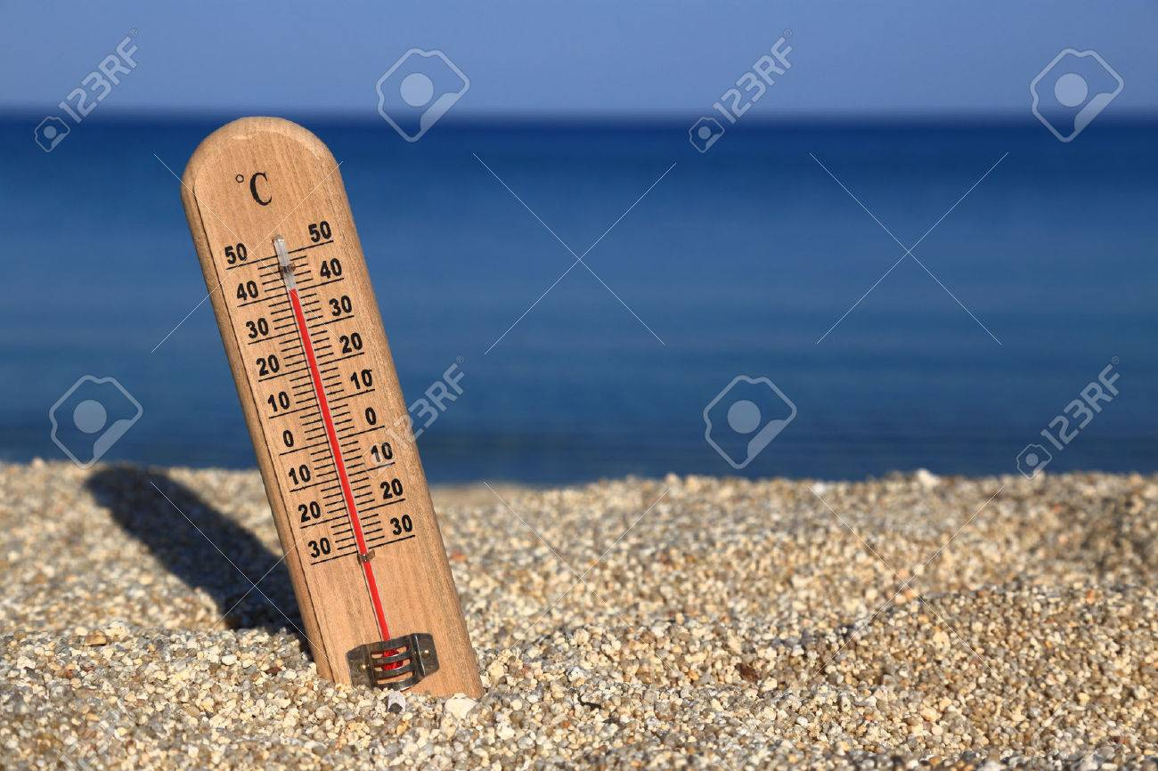 Thermometer on a beach shows high temperatures - 28872029
