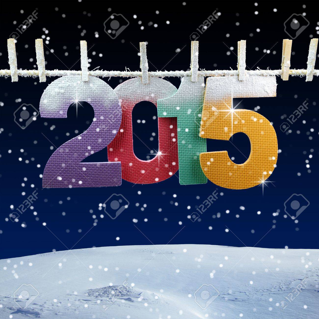 Number 2015 hanging on a clothesline in a night wintry background Stock Photo - 29112537