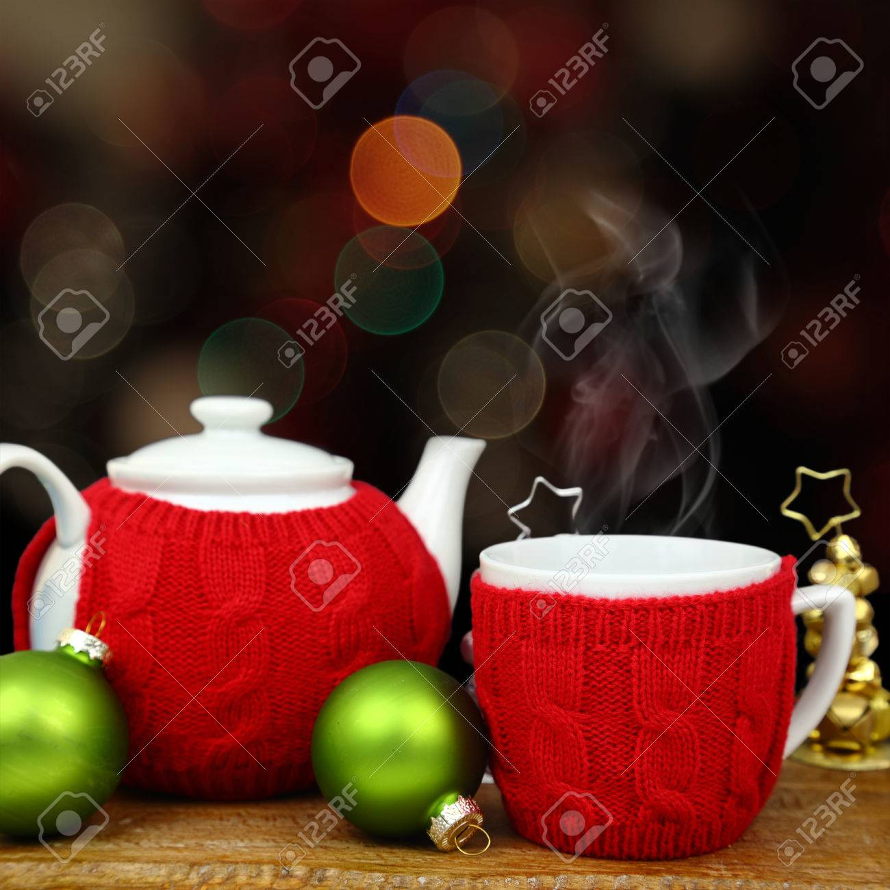 Christmas decoration, teapot and cup in front of sparkle lights Stock Photo - 30990112