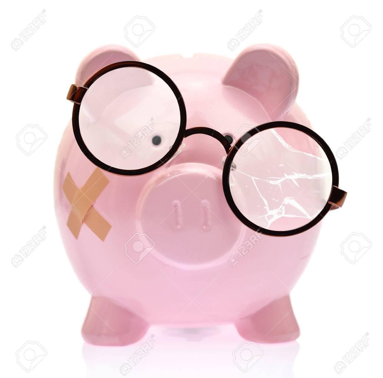 Piggy bank with broken eyeglasses and bandage Stock Photo - 31238576