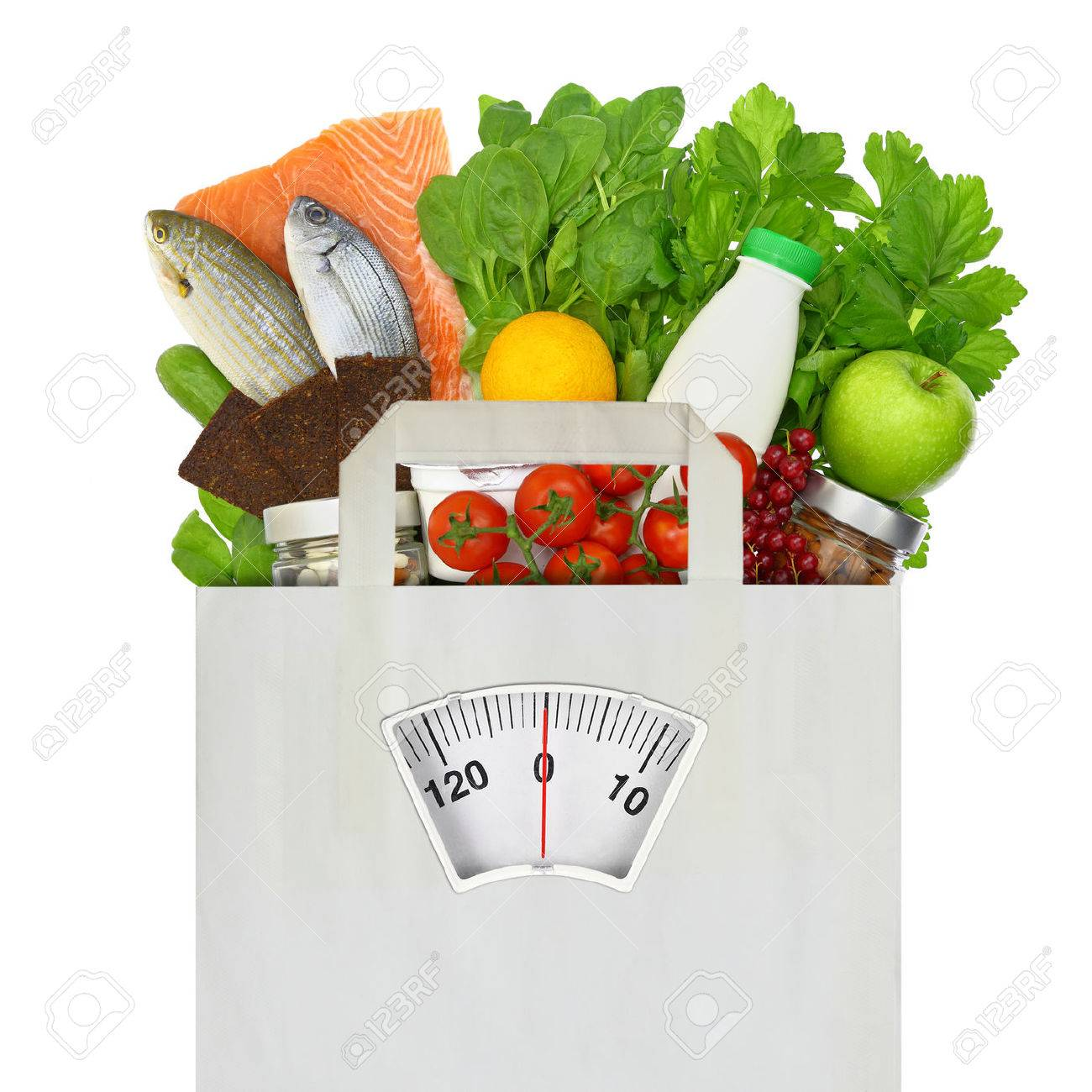 Paper bag full of groceries with weighing scale Stock Photo - 32264889