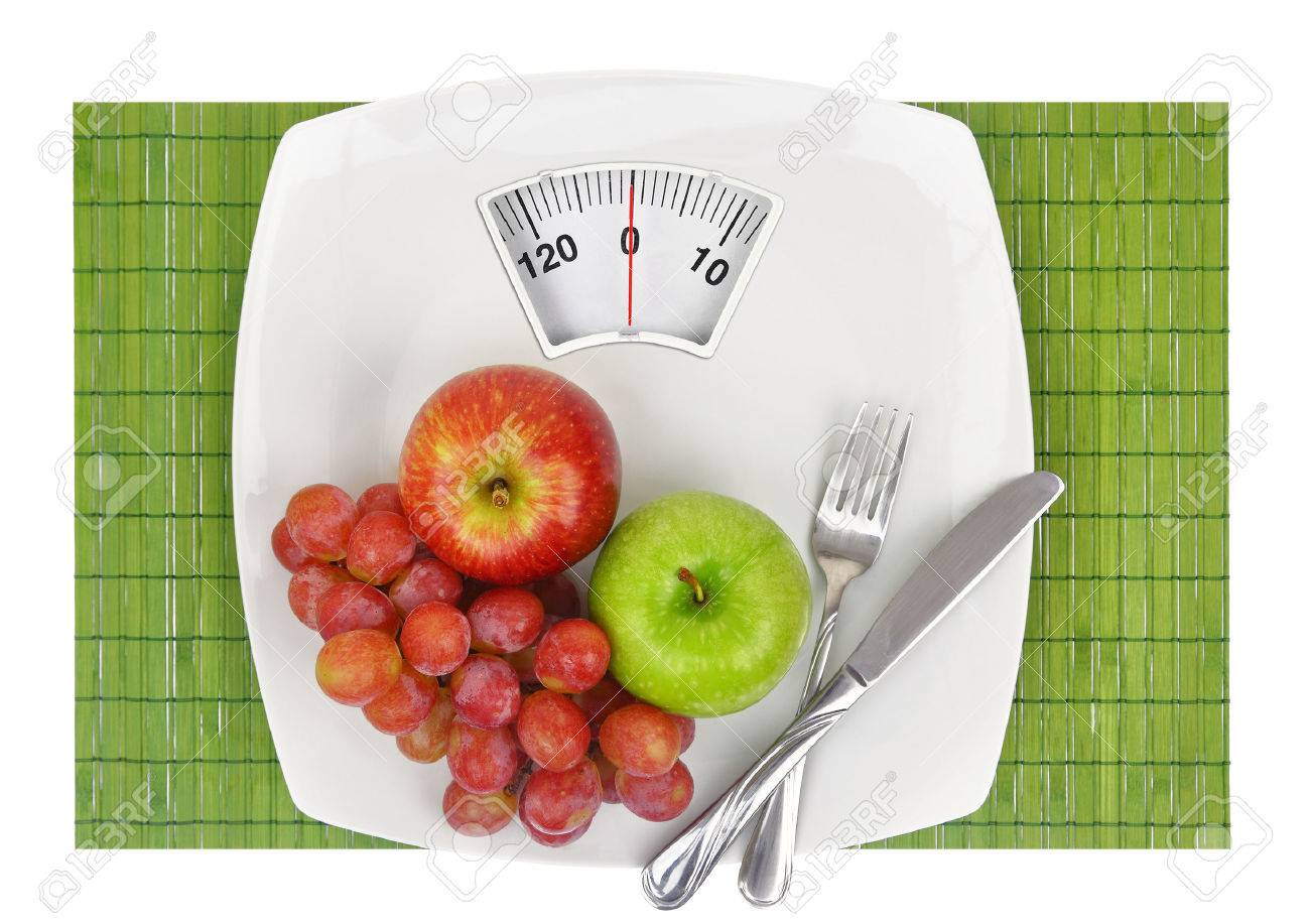 Fresh fruit on a plate with weighing scale Stock Photo - 32264899