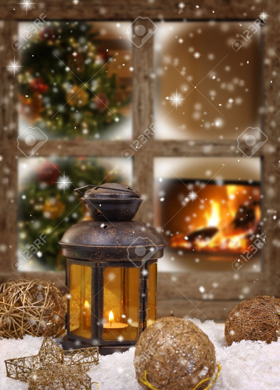Christmas lantern and ornaments on snow in front of a window Stock Photo - 32637310