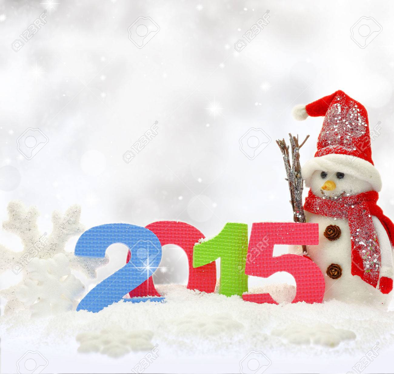 Snowman and new year 2015 on snow Stock Photo - 33266940