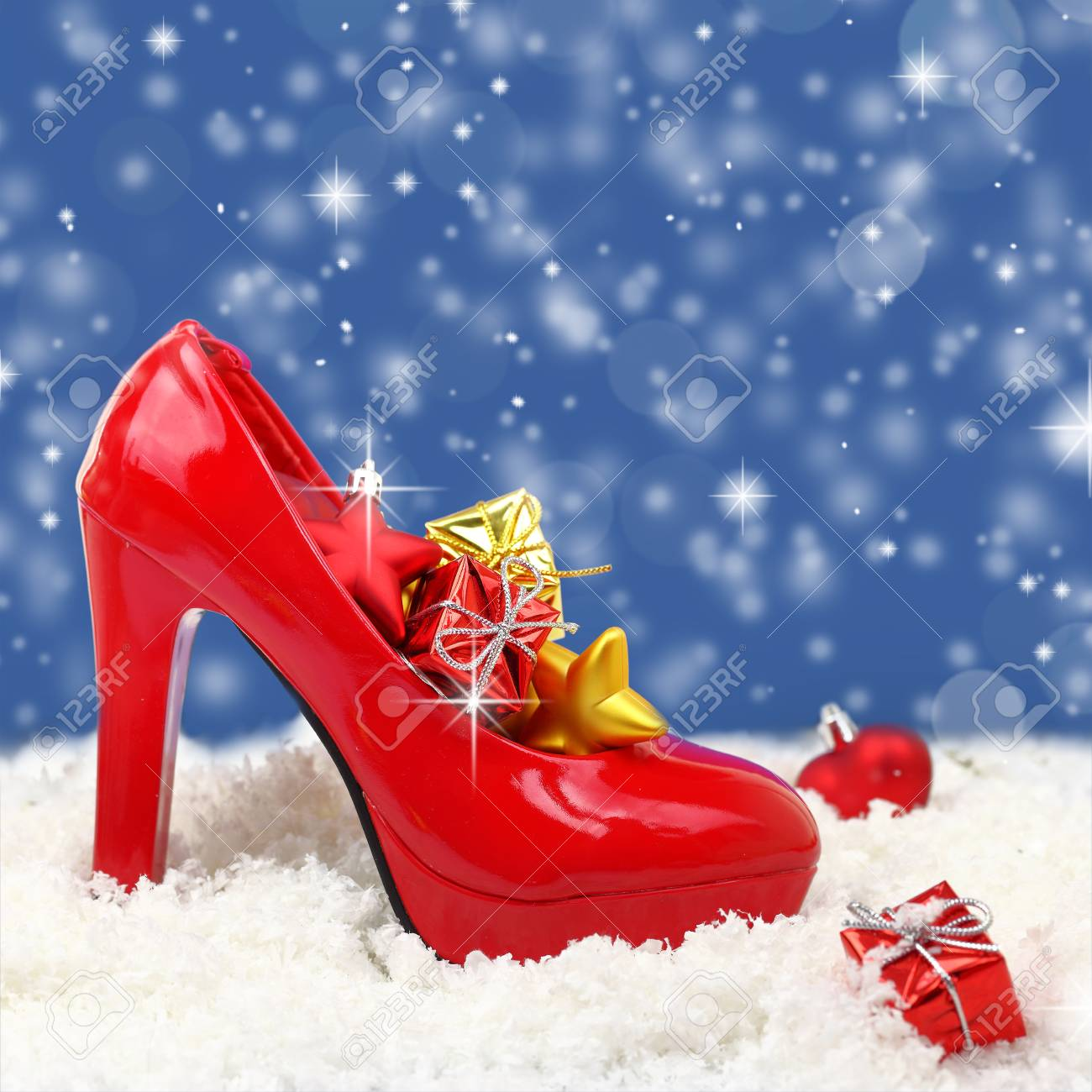 high heel shoe with christmas ornaments on snow stock photo 33266942 - Shoe Christmas Ornaments