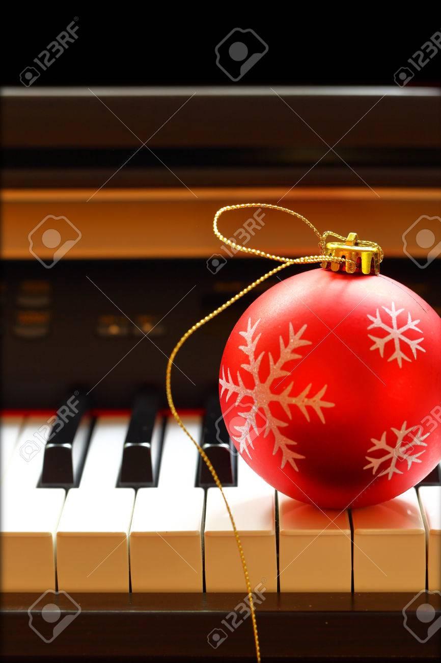 Christmas ball on piano keys Stock Photo - 33267711