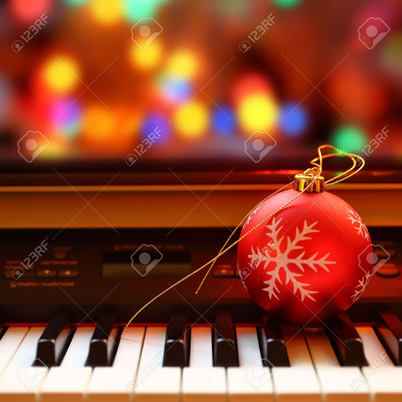 Christmas ball on piano keys Stock Photo - 33267778