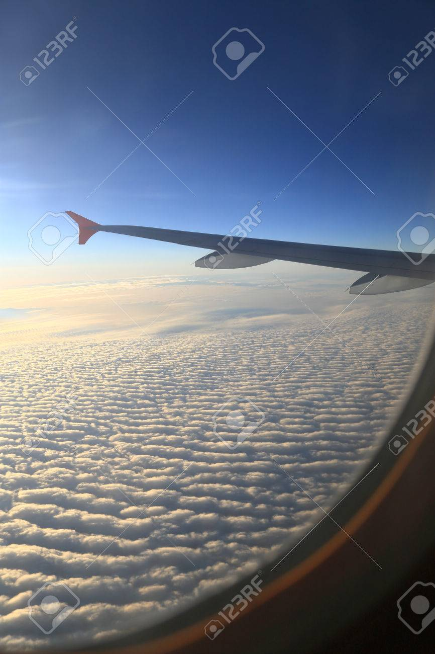 sky view of airplanes window clouds and wing aerial photography