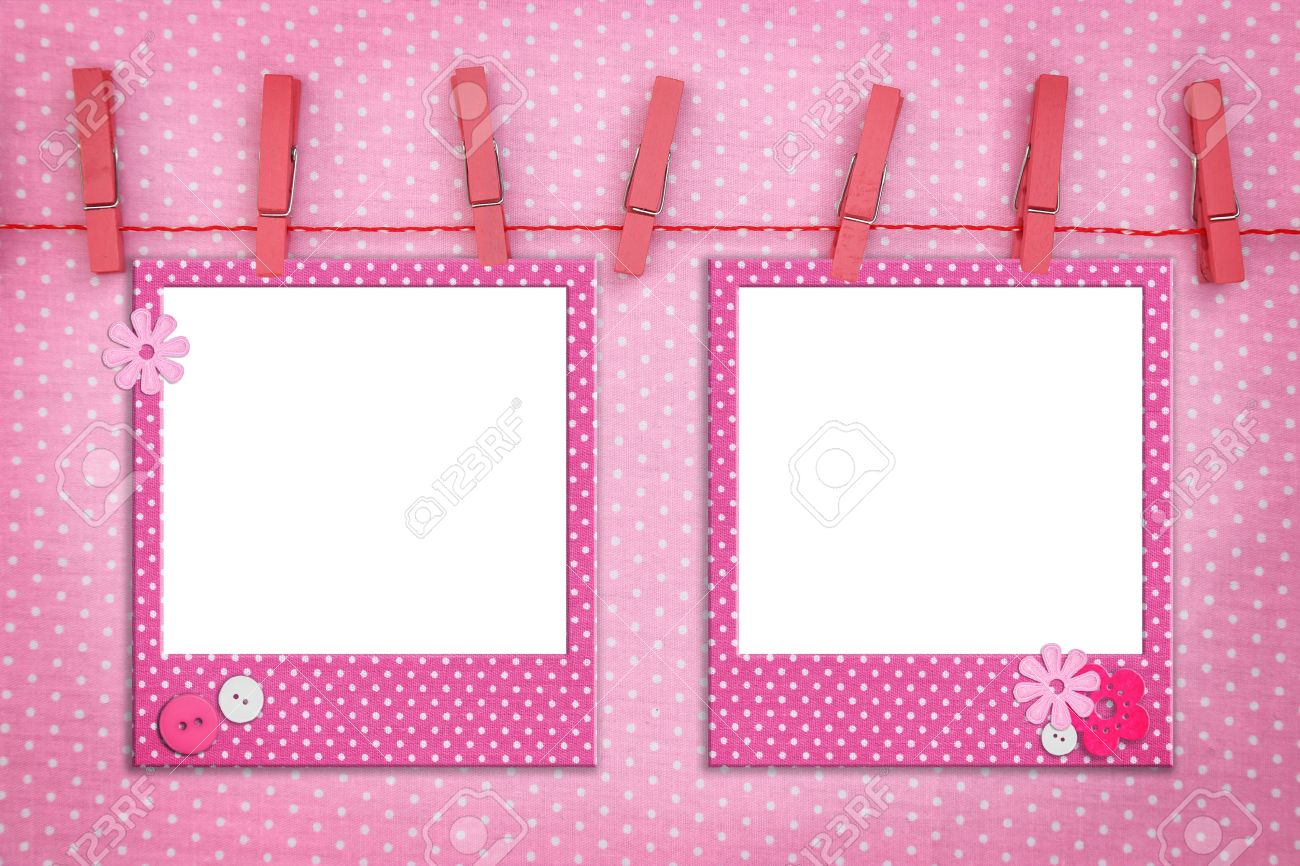 baptism pink photo frames hanging on a rope