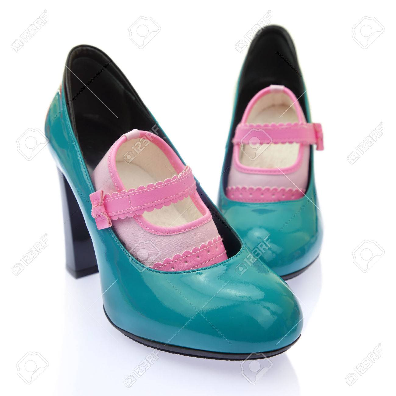 Baby shoes on mom's high heels Stock Photo - 35916469