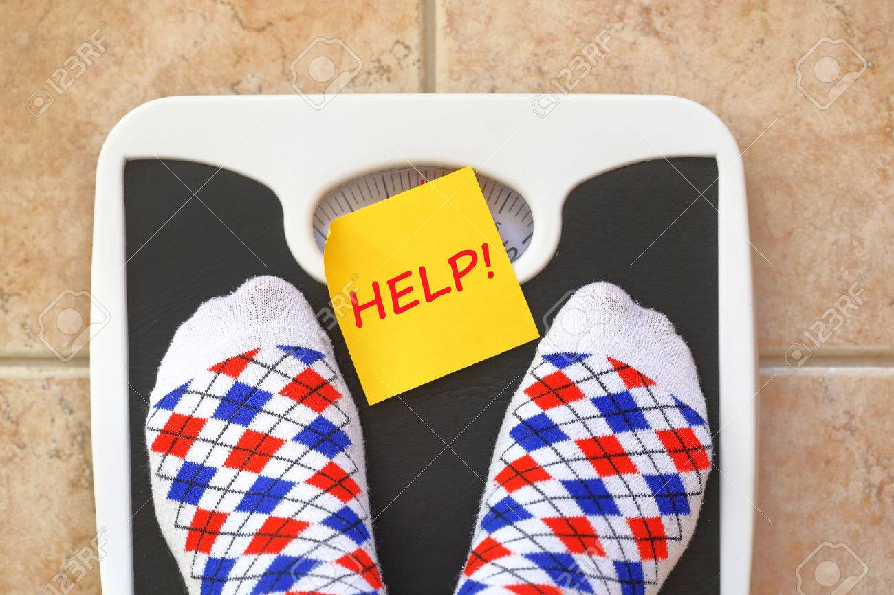 Woman's feet on bathroom scale. Diet concept Stock Photo - 37490634