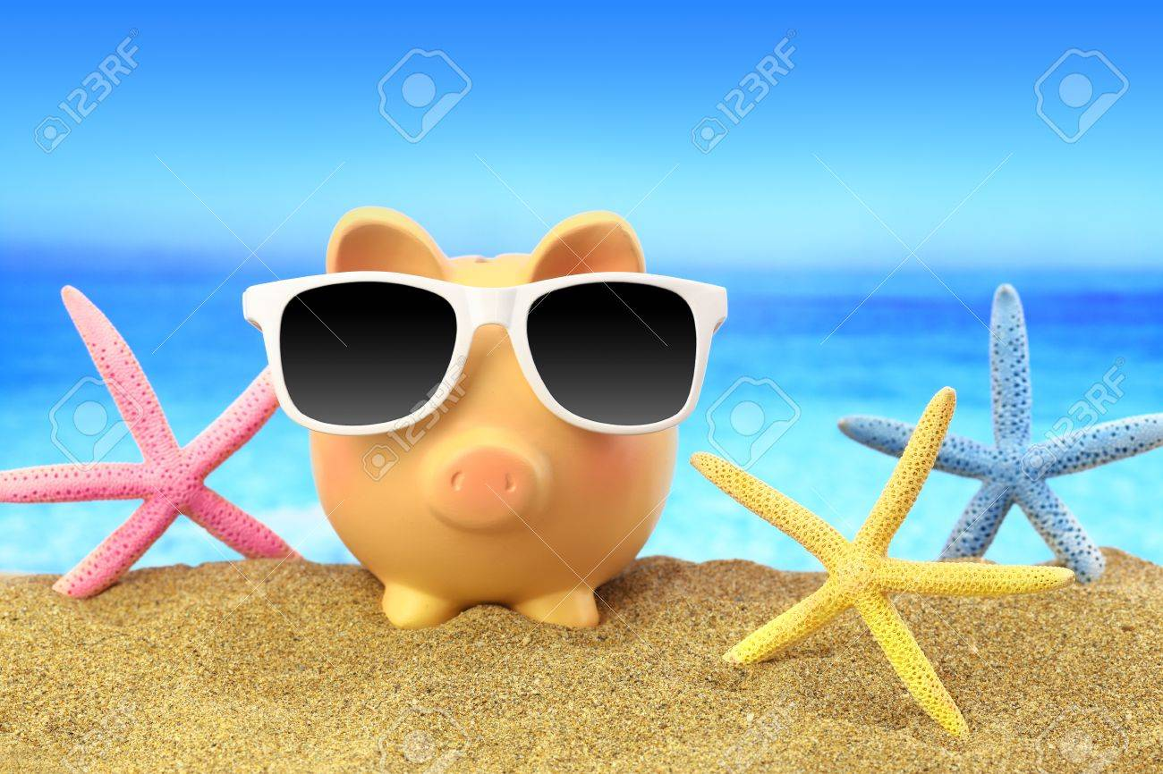 Summer piggy bank with sunglasses and starfishes on beach Stock Photo - 39562207